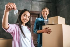 beautiful interracial couple moving into new home